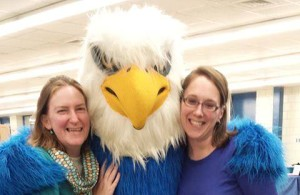 Previous YA Library (and current Assistant Director) Amy Rhilinger, the AHS Blue Bombardier Mascot, and Cate Merlin, YA Librarian at Blue Pride Night 2013